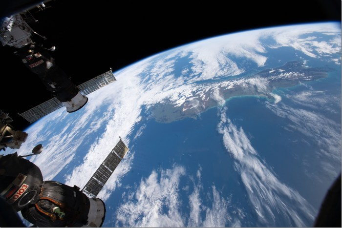 Two Russian spacecraft docked to the International Space Station, (bottom left) the Soyuz MS-09 crew ship and (top left) the Progress 70 cargo craft, are pictured as the orbital complex orbited nearly 262 miles above New Zealand. Credits: NASA