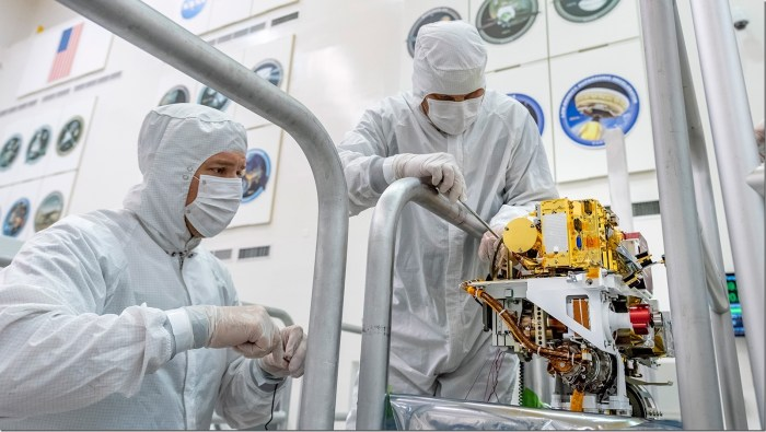 In this image taken June 25, 2019, engineers install the SuperCam instrument on Mars 2020's rover. This image was taken in the Spacecraft Assembly Facility at NASA's Jet Propulsion Laboratory, Pasadena, California. Credits: NASA/JPL-Caltech