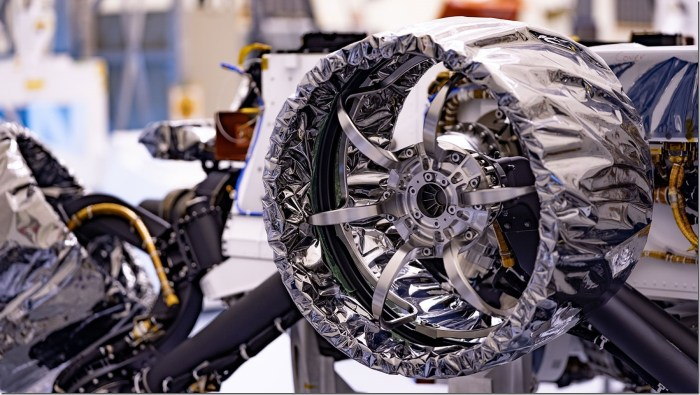 This wheel, and five others just like it, heads to Mars on NASA's Perseverance rover this summer. Wrapped in a protective antistatic foil that will be removed before launch, the wheel is 20.7 inches (52.6 centimeters) in diameter. The image was taken on March 30, 2020, at NASA's Kennedy Space Center. Credits: NASA/JPL-Caltech