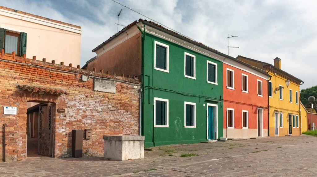 The island of Mazzorbo has the same colorful houses that make Burano appealing