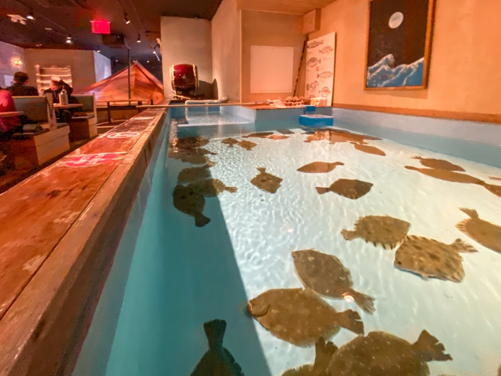 Head upstairs at Zauo chelsea seafood restaurant in New York and discover tanks of flounders and lobsters