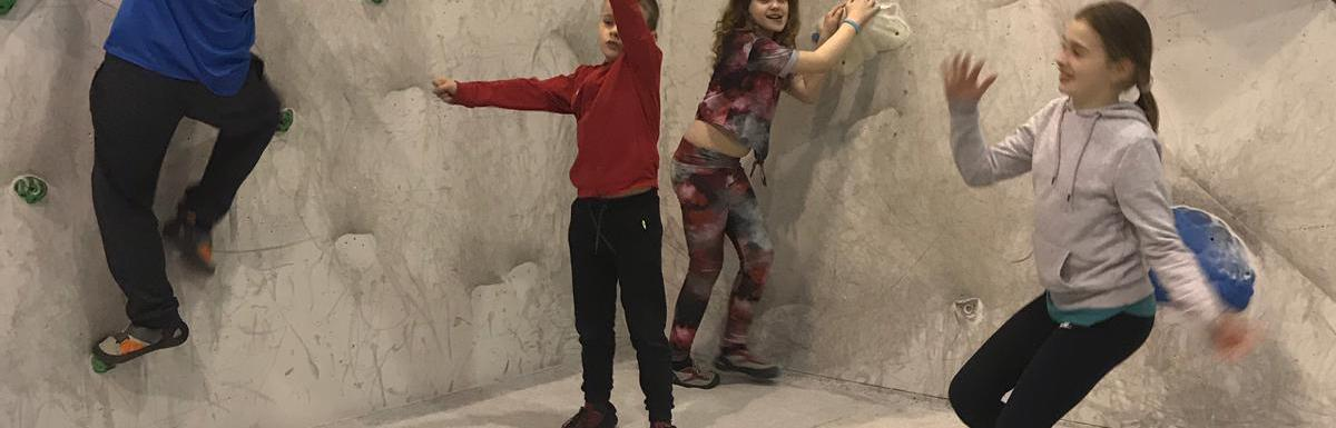 Children enjoy bouldering session