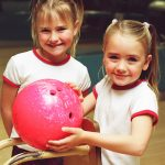 Young girls bowing at Wave Bowl