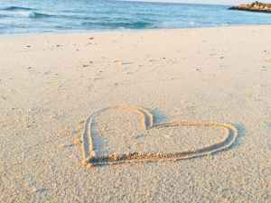 a heart drawn in the sand at a beach in southern calfornia