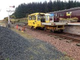 The Permaquip Patrolmen's and trailer sit in the platform next to the compound awaiting loading with ballast