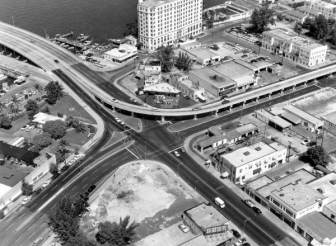West Avenue, Alton Rd, 5th Street, and MacArthur Causeway. The Floridian Hotel is in the background, 1958.