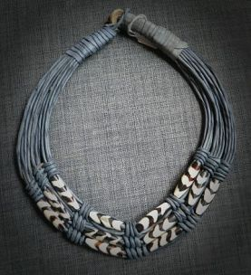 Leather necklace made of tinted camel bones