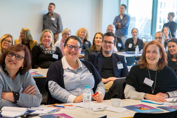 Smiling attendees at WayAhead Workplaces Forum 2018