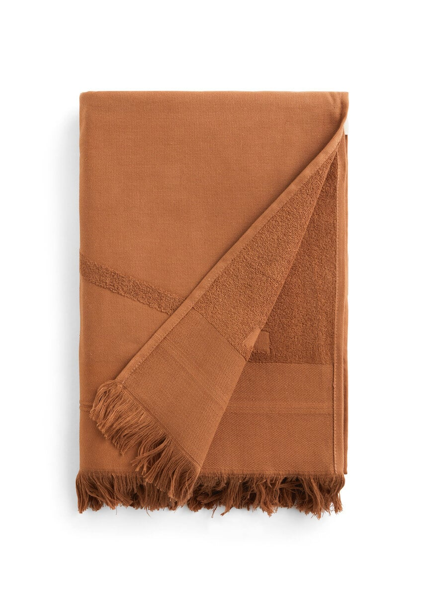 Folded brown WAY beach towel with woven front and terry back and fringes