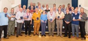 Wayfarers Chorus members with their 30th anniversary memento