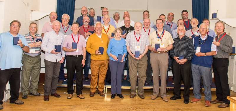 Wayfarers Chorus members with their 30th anniversary memento