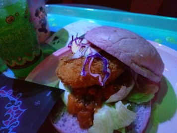 close up on Halloween burger with purple bun
