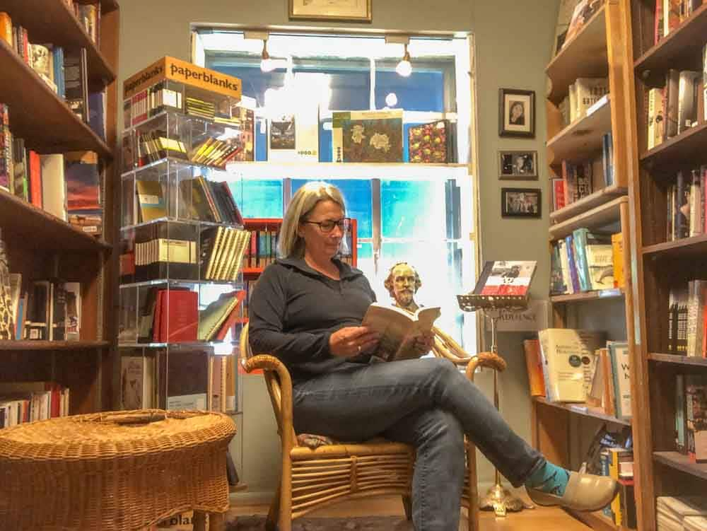 Salt Lake City bookstores: King's English bookshop. Woman in chair reading a book