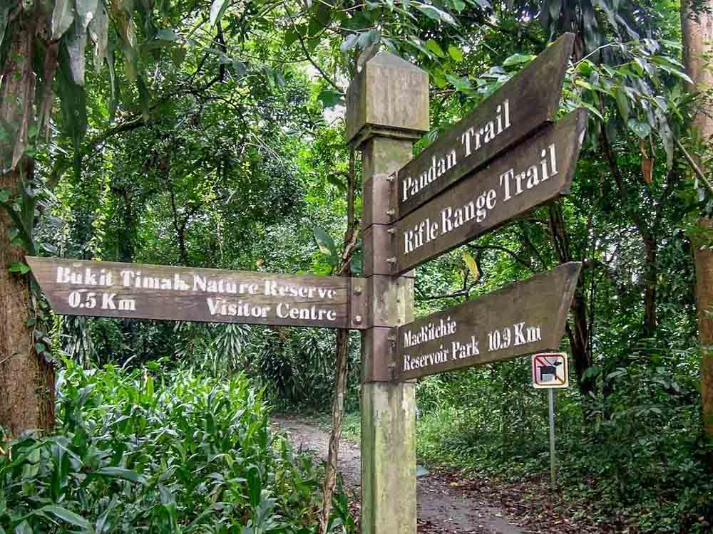 Unuaual places in Singapore: Bukit Timah Nature Reserve sign with trees