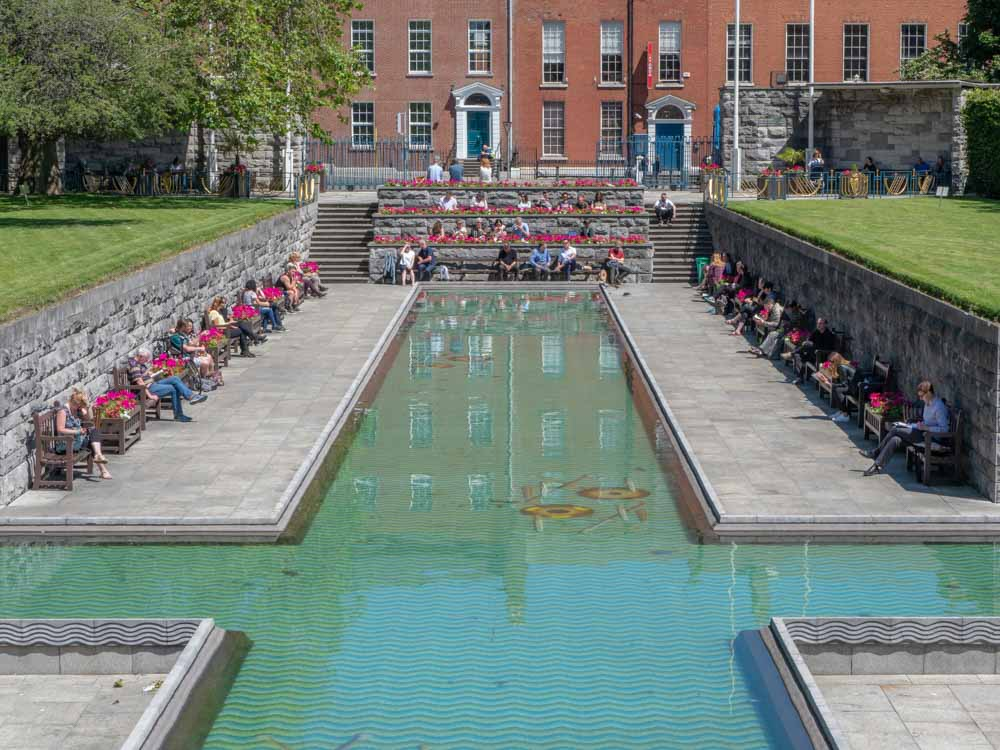 Dublin garden of remembrance- pool with people sitting eating lunch
