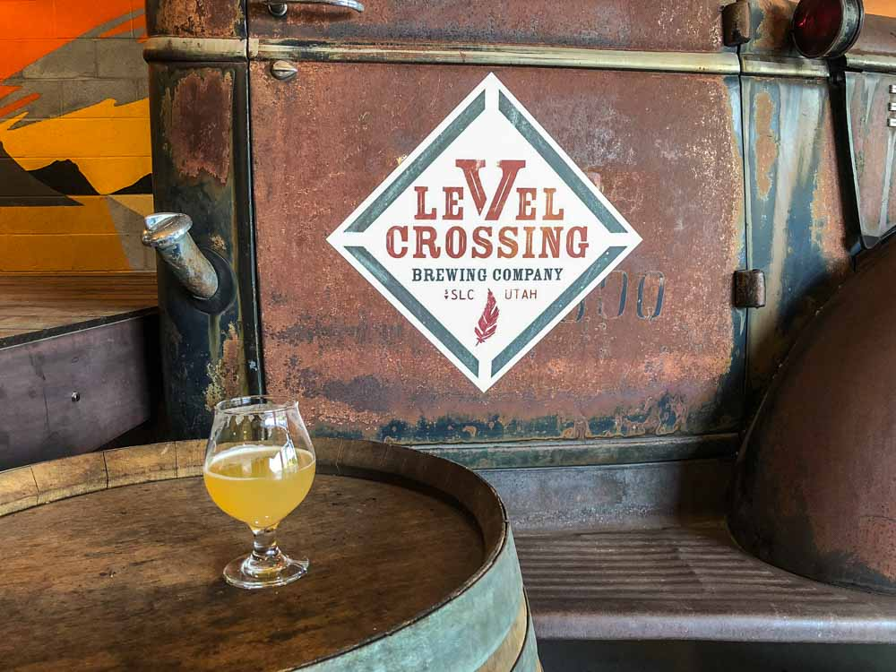 Salt Lake City Breweries: Level Crossing. Beer glass with brewery sign