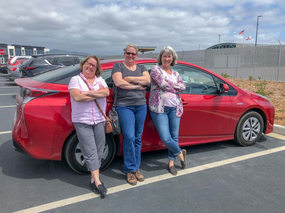 Pacific Coast Highway trip three friends, red Prius