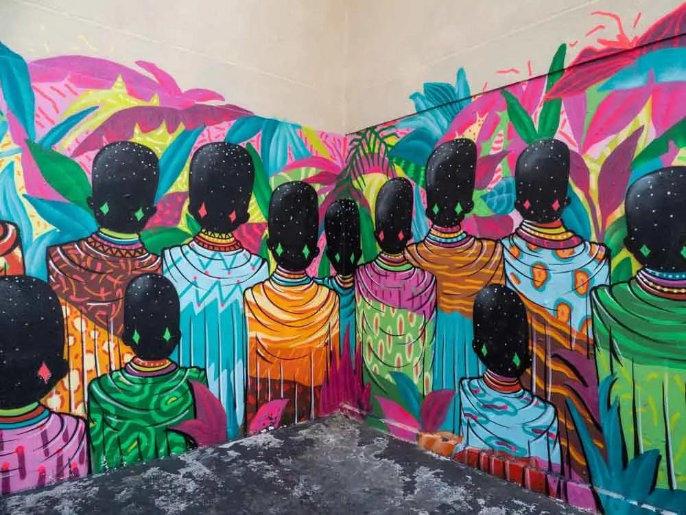 Street art in Paris Belleville. Colorful batik figures By Toz FBC