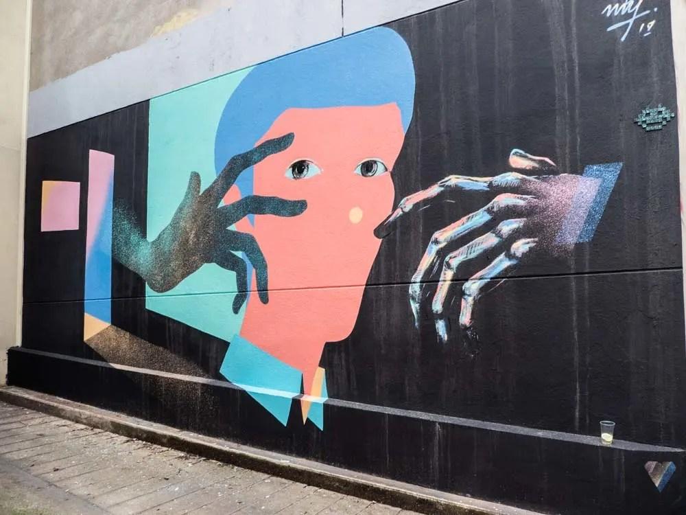 Belleville Paris street art mural by Txemy