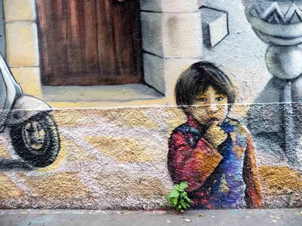 Paris street art mural of a small boy
