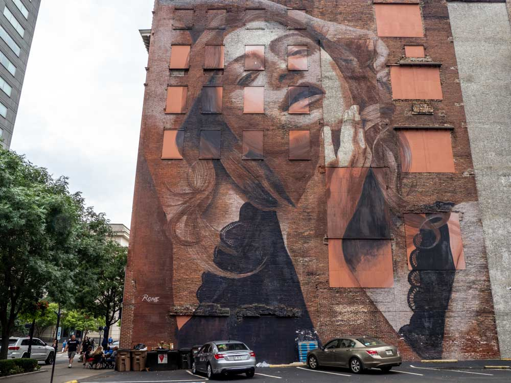 Mural by Rone in Nashville- brown woman