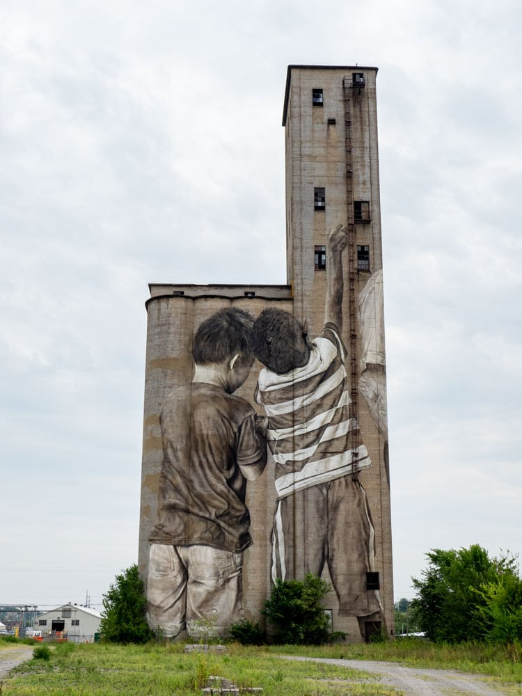 Guido Van Helten mural in Nashville- of two kids on a silo