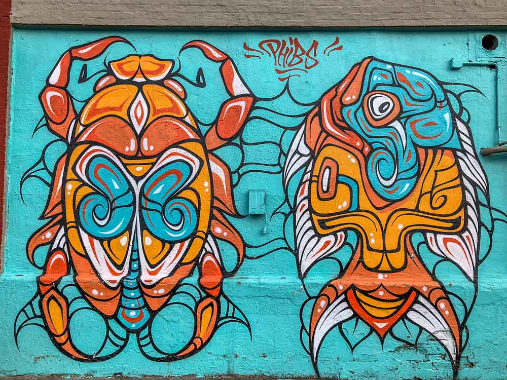 Phibs mural in Brooklyn blue and orange bugs