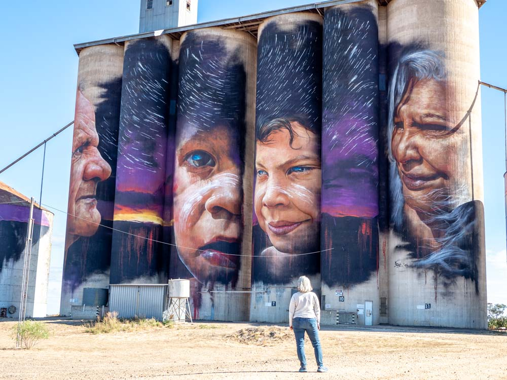 Sheep Hills silos by Adnate. Four aboriginal Australians with a purple mural