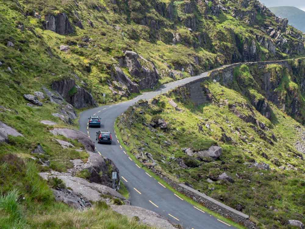 Driving in Ireland on the Conor Pass. Two cars on narrow mountain road
