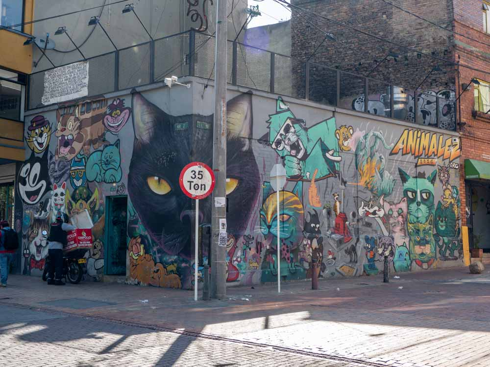 Mural in Bogota- cats by ION totles, Multiple cats on two exterior walls