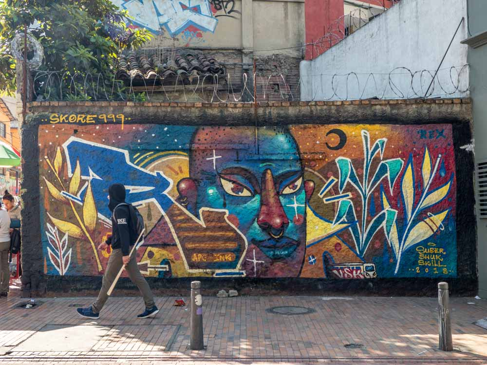 Bogota blue face mural by skore999