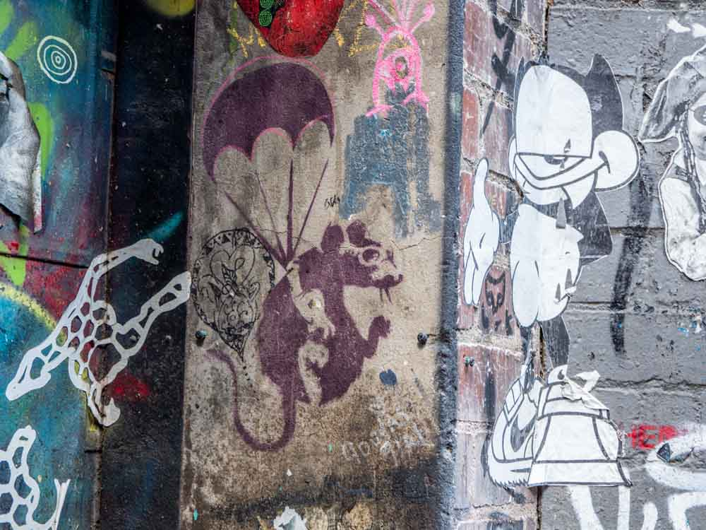 Melbourne Banksy stencil Duckboard place. Purple rat