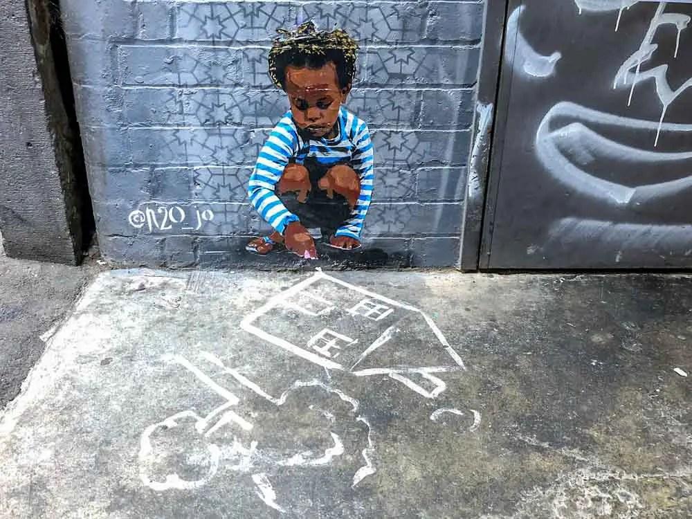 Graffiti Lane Melbourne: N2OJo stencil - boy playing with toys