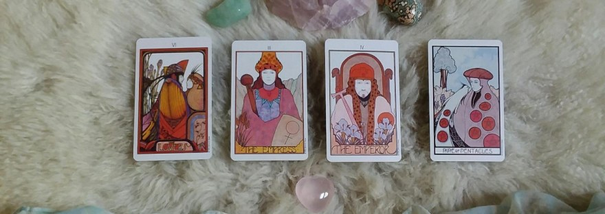 Tarot Spread with four cards and crystals on flokati rug