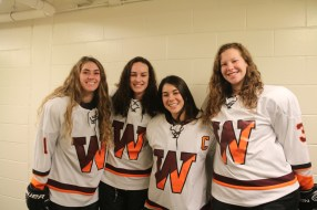[Photo credit: Deb LaPierre] The event will also feature the Wayland/Weston girls team playing Boston Latin School at 7pm. Pictured are (l. to r.) Cassie O'Heron and captains Brooke LaPierre, Lilly Lin and Savannah Salitsky.