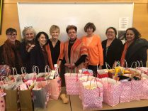 Roundtable board members pose with 2020 Valentines Day gift bags