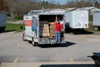 A Save the Children staff member finishes loading supplies for delivery to Eastern Kentucky on Friday, April 3, 2020 at their distribution warehouse. Save the Children is distributing essential materials to children across rural America as they adjust to coronavirus related school closures making sure children are able to continue to learn while they're home from school.