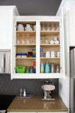 organized-kitchen-cabinet-with-kid-dishes-and-glasses