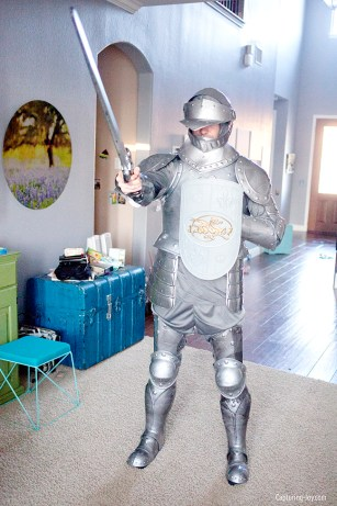 """Person dressed in a suit of armor costume with a sword """"Armor of God"""""""