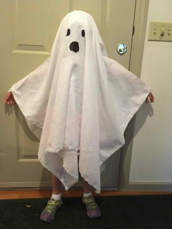 Kid dressed as a ghost for halloween
