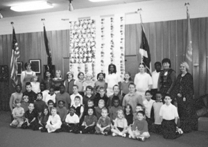 Mrs. Hall's (2nd from right), morning Kindergarten Class and Mrs. Schopfer's fourth grade class. Student teacher, Angie Cope is far right.