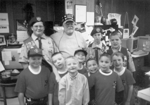 (F-B) Tiger Cubs learning about newspapering. Submitted by Ray McCune