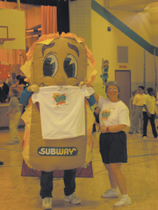"""Ms. Darla Davis, Maplewood Elementary's Jump Rope for Heart organizer, and the """"Subway Man"""" gave away t-shirt's to participants jumping rope on Friday, February 15, 2005."""