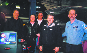 Roppel representatives, Brian Densford, Dennis Husband, Steve Yankowy and John Adams, work with owner Rich Elzey of Rich's Auto Center on Thursday, March 10, 2005.