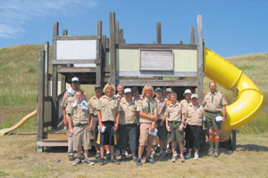 photos by Bill Reiman and Tom Watson Aldersgate United Methodist Church Boy Scout Troop 349 pose in front of the Bear Creek Playground that they helped to restore.