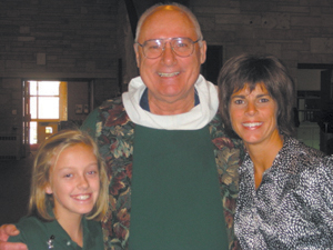 Erin's House provides support services for children, teens and their families who anticipate or have suffered the death of a loved one. Pictured Annie Childers, Fr. Tim Wrozek, Katie Burns.