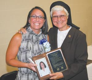 Kely Sandels receives Athletic Hall of Fame award from Sister Elise.