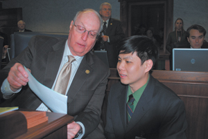 Sen. Thomas Wyss (left) goes over a piece of legislation with intern Steven Truong of Fort Wayne.