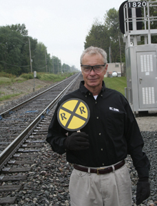 Operation Lifesaver Presenter, Doug Wylie at the railroad crossing on Lower Huntington Road in Waynedale.