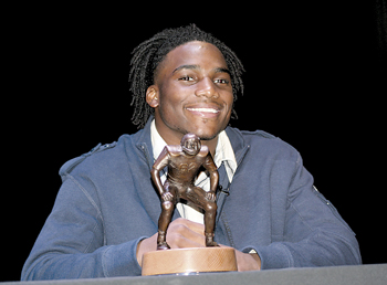 "Jaylon Smith proudly holds his Butkus Award in which the inscription reads, ""When a player receives the Butkus Award he will know two things. First, he is recognized as the best of the best linebackers in America. Second, and in the long run most important, he will understand that this recognition brings a responsibility to serve others by giving back.-Dick Butkus."""